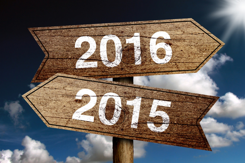 New year 2016 road sign with cloudy sky background.